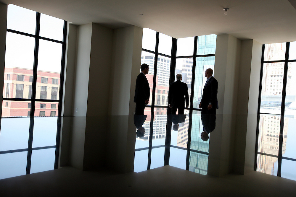 Joe Grunnet, right, and Josh Neumann, left, of Downtown Resource Group show interested buyer Keith Saxon a condo on the 22nd floor of the Ivy Hotel + Residences in downtown Minneapolis August 24, 2012.