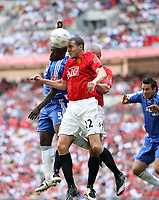 Photo: Rich Eaton.<br /> <br /> Manchester United v Chelsea. FA Community Shield. 05/08/2007. Manchester UNited's John O'Shea (r) leaps with Chelsea's Michael essien to head the ball