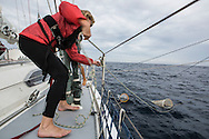 North Atlantic Ocean, September 2014.<br /> Crew member Carrina Gaffney holds one of the trawls used to gather samples on board the Sea Dragon.<br /> &copy; Chiara Marina Grioni