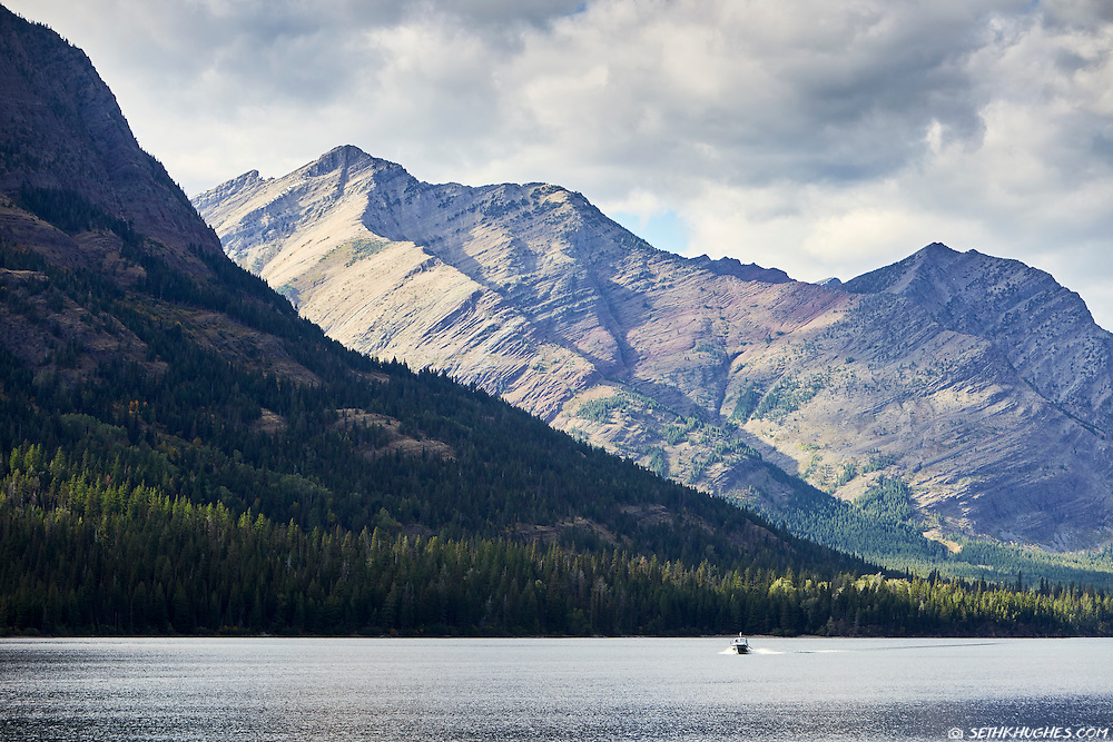 A park ranger boat patrols Waterton Lake in the Waterton-Glacier International Peace Park, Montana.