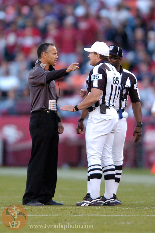 Nov 5, 2006 San Francisco, CA, USA: San Francisco 49ers head coach Mike Nolan (left) talks to NFL referee Ed Hochuli (85) during the second half against the Minnesota Vikings at Monster Park. The 49ers defeated the Vikings 9-3.
