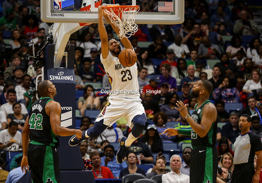 Mar 18, 2018; New Orleans, LA, USA; New Orleans Pelicans forward Anthony Davis (23) dunks over Boston Celtics forward Al Horford (42) and guard Kadeem Allen (45) during the second half at the Smoothie King Center. The Pelicans defeated the Celtics 108-89. Mandatory Credit: Derick E. Hingle-USA TODAY Sports