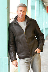 man in a leather jacket outdoors