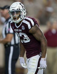 Texas A&M defensive back Armani Watts (23) listens for a call during the first quarter of an NCAA college football game against South Carolina Saturday, Sept. 30, 2017, in College Station, Texas. (AP Photo/Sam Craft)