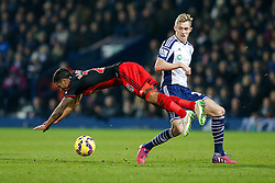 Kyle Naughton of Swansea City takes a tumble as Darren Fletcher of West Brom tackles him - Photo mandatory by-line: Rogan Thomson/JMP - 07966 386802 - 11/02/2015 - SPORT - FOOTBALL - West Bromwich, England - The Hawthorns - West Bromwich Albion v Swansea City - Barclays Premier League.
