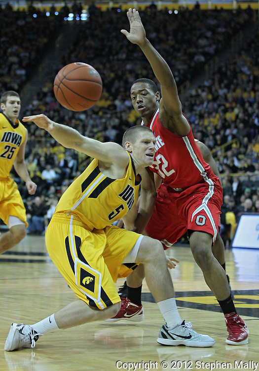 January 07, 2011: Iowa Hawkeyes guard Matt Gatens (5) loses the ball as he drives against Ohio State Buckeyes guard Lenzelle Smith Jr. (32) during the the NCAA basketball game between the Ohio State Buckeyes and the Iowa Hawkeyes at Carver-Hawkeye Arena in Iowa City, Iowa on Saturday, January 7, 2012.