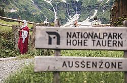 THEMENBILD - eine arabische Touristin geht auf einem Weg. Im Vorderung das Nationalpark Aussenzone Schild. Der Hintersee ist ein kleiner Gebirgssee in 1313 m Höhe im Talschluss des Felbertals in Mittersill. Der Bergsee ist ein Naturdenkmal und wurde unter Schutz gestellt. Der Hintersee gilt als Geheimtipp, Erholungsgebiet und ein Platz, den man gesehen haben muss, aufgenommen am 23. Juni 2019, am Hintersee in Mittersill, Österreich // an Arab tourist goes one way. In front the national park outer zone sign. Hintersee is a small mountain lake 1313 m above sea level at the end of the Felbertal valley in Mittersill. The mountain lake is a natural monument and was placed under protection. The Hintersee is an insider tip, a place you must have seen and a recreation area on 2019/06/23, Hintersee in Mittersill, Austria. EXPA Pictures © 2019, PhotoCredit: EXPA/ Stefanie Oberhauser