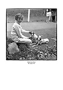 Young child with dogs at the Dublin Horse Show.<br />