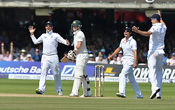 © Licensed to London News Pictures. 21/07/2013. Graeme Swann and Nick Cook celebrate the wicket of Haddin on day 4 of the Second Test England v Australia The Ashes Lord's Cricket Ground, London on July 21, 2013. England won the match taking a 2 - 0 lead in the series. Photo credit: Mike King/LNP