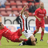 Dunfermline v Stirling....26.07.08  Challenge Cup<br /> Graham Bayne is brought done by Ross Forsyth<br /> Picture by Graeme Hart.<br /> Copyright Perthshire Picture Agency<br /> Tel: 01738 623350  Mobile: 07990 594431