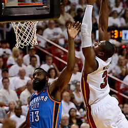 Jun 17, 2012; Miam, FL, USA; Miami Heat shooting guard Dwyane Wade (3) dunks over Oklahoma City Thunder guard James Harden (13) during the fourth quarter in game three in the 2012 NBA Finals at the American Airlines Arena. Miami won 91-85. Mandatory Credit: Derick E. Hingle-USA TODAY SPORTS