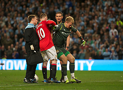MANCHESTER, ENGLAND - Monday, April 30, 2012: Manchester City's Joe Hart is picked off the floor by Manchester United's Wayne Rooney during the Premiership match at the City of Manchester Stadium. (Pic by Chris Brunskill/Propaganda)