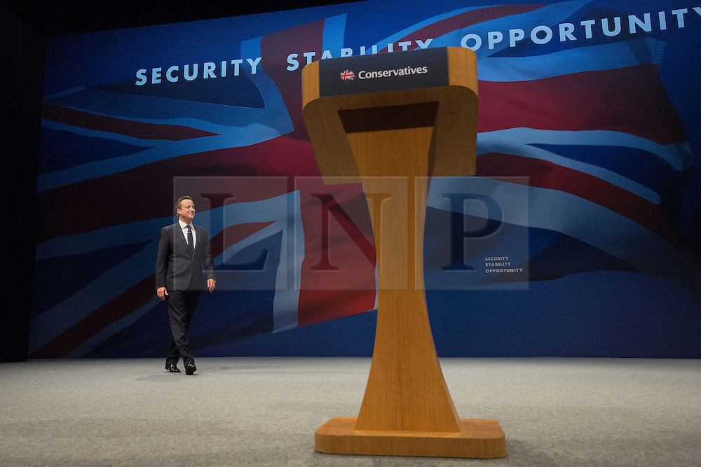 © Licensed to London News Pictures . 07/10/2015 . Manchester , UK . Prime Minister DAVID CAMERON steps on stage to deliver the leader's speech . The Conservative Party Conference at the Manchester Central Convention Centre . Photo credit : Joel Goodman/LNP