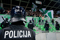 Policeman watching Green Dragons during football match between NK Olimpija and NK Maribor in Prva Liga, March 12, 2011 at SRC Stozice, Ljubljana, SLO. (Photo By Matic Klansek Velej / Sportida.com)