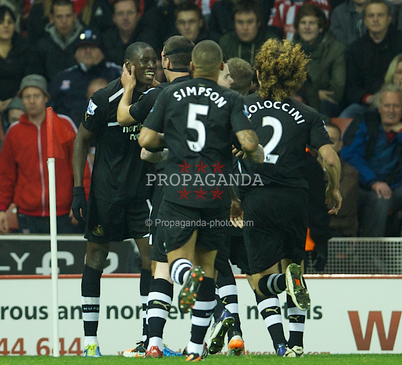 STOKE-ON-TRENT, ENGLAND - Monday, October 31, 2011: Newcastle United's Demba Ba celebrates scoring the second goal against Stoke City during the Premiership match at the Britannia Stadium. (Pic by David Rawcliffe/Propaganda)