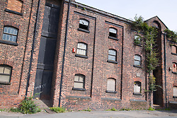 Derelict warehouse on the bank of the Leeds & Liverpool Canal Bootle; Liverpool; England