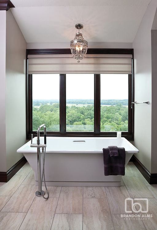 Bathtub in a modern bathroom with an amazing view. Photo by Brandon Alms Photography