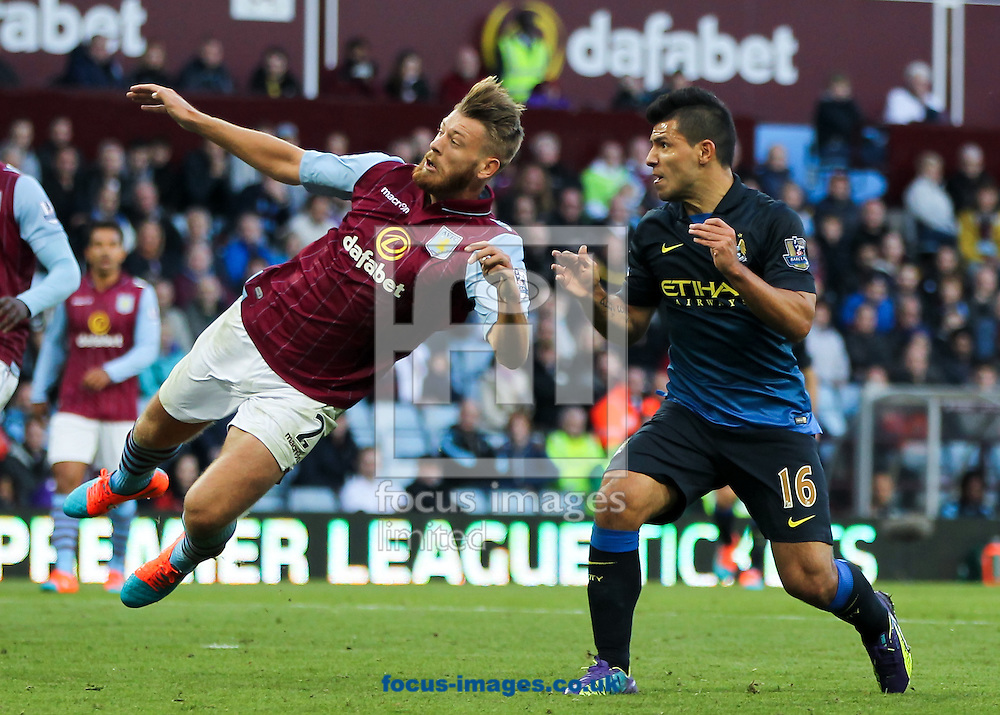 Nathan Baker (left) of Aston Villa and Sergio Ag&uuml;ero (right) of Manchester City during the Barclays Premier League match at Villa Park, Birmingham<br /> Picture by Tom Smith/Focus Images Ltd 07545141164<br /> 04/10/2014