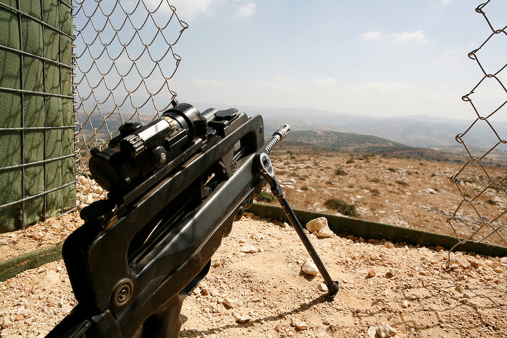 "Originally created in 1978, The United Nations Interim Force in Lebanon (UNIFIL) was created to ensure oversee an Israeli withdrawal from Lebanon, who at that time began its occupation of southern Lebanon that lasted until 2000. After the Israeli war on Lebanon in 2006, UNIFIL enhanced its presence in southern Lebanon to monitor the cessation of hostilities. ..Pictured: A lookout post at the UNIFIL French camp ""2.45"" in al-Tiri in southern Lebanon. The French soldier is not allowed to hold the gun in this position because it would be considered an ""aggressive move against the Lebanese."""