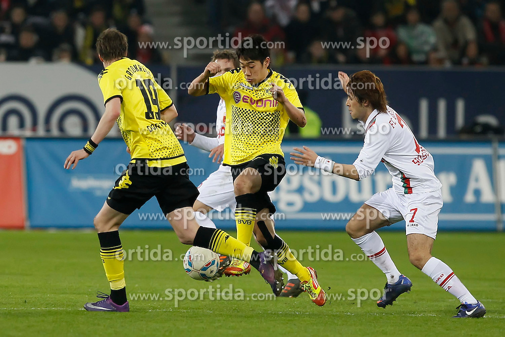 10.03.2012, SGL Arena, Augsburg, GER, 1. FBL, FC Augsburg vs Borussia Dormund, 25. Spieltag, im Bild Shinji KAGAWA (Bor. Dortmund) spielt den Ball, setzt sich durch gegen Hajime HOSOGAI (FC Augsburg, re.) // during the German Bundesliga Match, 25th Round between FC Augsburg and Borussia Dormund at the SGL Arena, Augsburg, Germany on 2012/03/10. EXPA Pictures © 2012, PhotoCredit: EXPA/ Eibner/ Klaus Rainer Krieger..***** ATTENTION - OUT OF GER *****