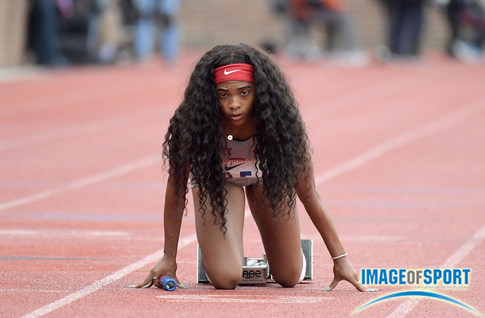 Apr 27, 2018; Philadelphia, PA, USA; Camri Austin of Oklahoma in the staring blocks of the Championship of America women's 4 x 100m relay during the 124th Penn Relays at Franklin Field.
