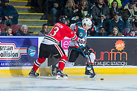 KELOWNA, CANADA - APRIL 14: Keegan Iverson #13 of the Portland Winterhawks back checks Nick Merkley #10 of the Kelowna Rockets at the boards on April 14, 2017 at Prospera Place in Kelowna, British Columbia, Canada.  (Photo by Marissa Baecker/Shoot the Breeze)  *** Local Caption ***