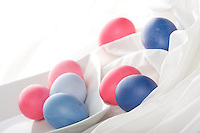 Blue and pink easter eggs on white background