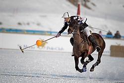 Pablo Jauretche of team Germany flying away with the ball<br /> St.Moritz Polo World Cup On Snow 2011<br /> © Dirk Caremans