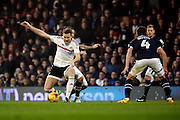 Derby County midfielder Bradley Johnson (15) fouling Fulham midfielder Kevin McDonald (06) during the EFL Sky Bet Championship match between Fulham and Derby County at Craven Cottage, London, England on 17 December 2016. Photo by Matthew Redman.