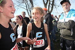 Collins' Gabriella Karas, center, is congratulated by teammate Brandi Pratt after winning the Girls 2A division of the 2011 KSHAA Cross Country Championship, held Saturday, 11, 12, 2011 at the Kentucky Horse Park in Lexington . Photo by Jonathan Palmer