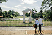 The Arch is a six-metre high Roman travertine sculpture positioned on the north bank of the Long Water. It was presented by the artist, Henry Moore, to the nation for siting in Kensington Gardens in 1980 - two years after his eightieth-birthday exhibition at the Serpentine Gallery, London.<br /> <br /> The Arch is made from seven travertine stones weighing a total of 37 tonnes. The stones were sourced from a quarry in northern Italy.