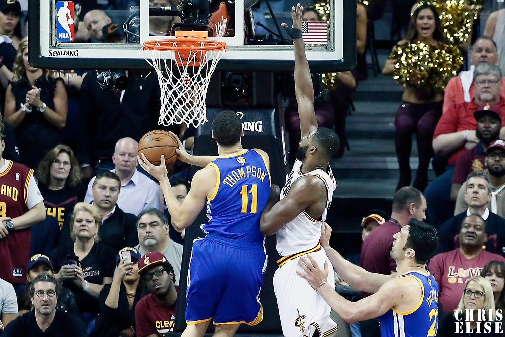 07 June 2017: Golden State Warriors guard Klay Thompson (11) goes for the layup against Cleveland Cavaliers center Tristan Thompson (13) during the Golden State Warriors 118-113 victory over the Cleveland Cavaliers, in game 3 of the 2017 NBA Finals, at  the Quicken Loans Arena, Cleveland, Ohio, USA.