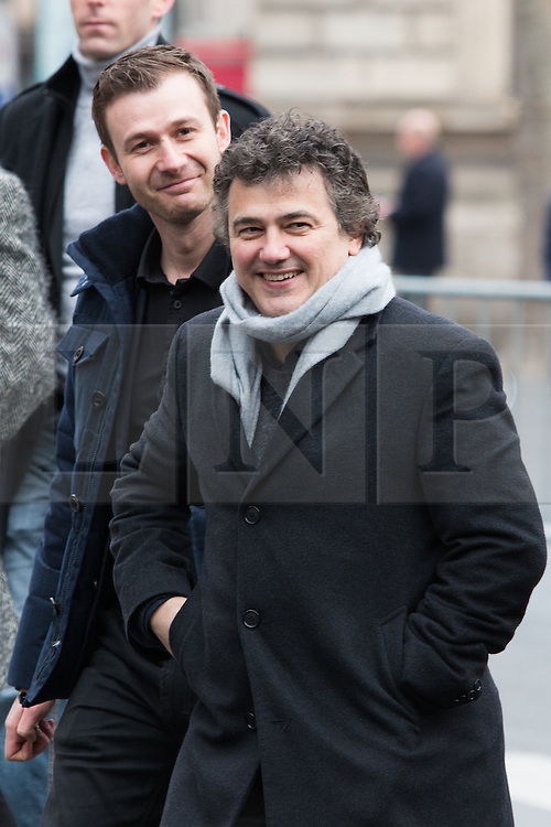 © Licensed to London News Pictures. 10/01/2016. France, Paris. Patrick Pelloux leaves after the anniversary ceremony on Place de le Republique surrounded by his 24/7 police protection. Today January 10th 2016. Photo credit: Hugo Michiels/LNP
