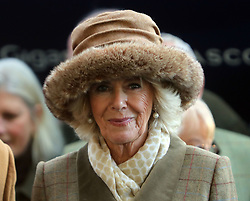 The Duchess of Cornwall presents the winning syndicate of Fortunate George after the horse won the Waitrose Handicap Steeple chase at Ascot Racourse.