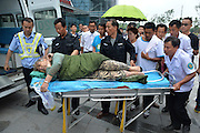 JINGZHOU, CHINA - JUNE 02: (CHINA OUT) <br /> <br /> Ship Carrying 458 People Sinks In Yangtze River In Jingzhou<br /> <br /> Paramedics carry a survivor, a 65-year-old woman, out of an ambulance at a hospital on June 2, 2015 in Jingzhou, Hubei province of China. A passenger ship named Dongfangzhixing (Eastern Star) carrying 458 people, including 406 Chinese passengers, 5 travel agency workers and 47 crew members aboard, according to the administration, sank at around 9:28 p.m. on Monday in the Jianli (Hubei Province) section of the Yangtze River. The captain and the chief engineer in eight people have been rescued and both claimed that the ship sank quickly after being attacked by cyclone. Chinese President Xijinping has ordered a work team of the State Council to rush to the site to guide search and rescue work, and rescue teams of Hubei, Chongqing and relevant parties to carry out all-search efforts and properly handle the aftermath.<br /> ©Exclusivepix Media