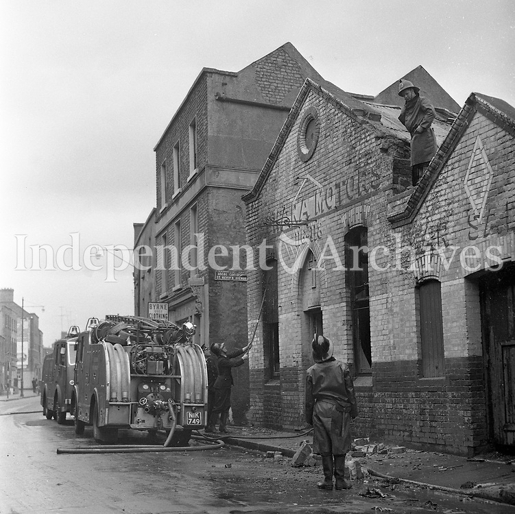 Fire brigade attending a scene in 1964. (Part of the Independent Newspapers Ireland/NLI Collection)