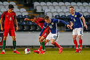 Kai Kennedy (Rangers FC) challenges Joao Daniel during the U17 European Championships match between Portugal and Scotland at Simple Digital Arena, Paisley, Scotland on 20 March 2019.