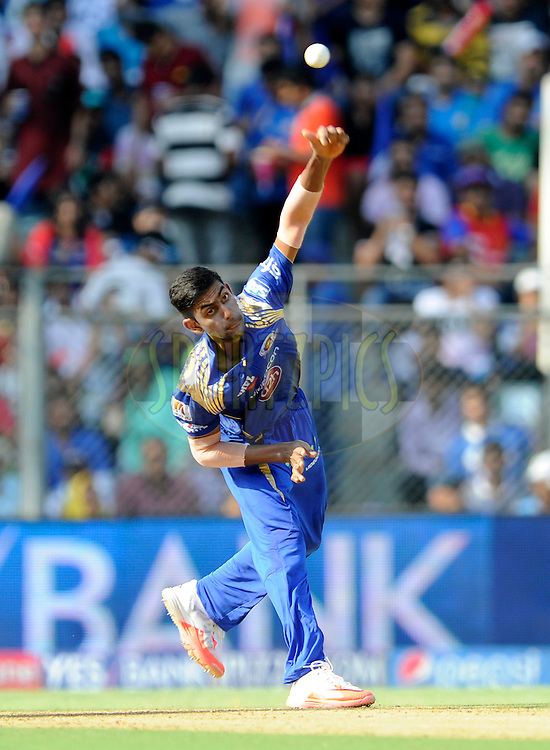 J Suchith of Mumbai Indians bowls during match 46 of the Pepsi IPL 2015 (Indian Premier League) between The Mumbai Indians and The Royal Challengers Bangalore held at the Wankhede Stadium in Mumbai, India on the 10th May 2015.<br /> <br /> Photo by:  Pal Pillai / SPORTZPICS / IPL