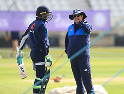 Jos Buttler speaks with coach Trevor Bayliss during the nets session at Trent Bridge, Nottingham.