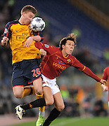 Nicklas Bendtner and Rodrigo Taddei compete for the ball during the UEFA Champions League, Round of Last 16, Second Leg match between AS Roma and Arsenal at the Stadio Olimpico on March 11, 2009 in Rome, Italy.