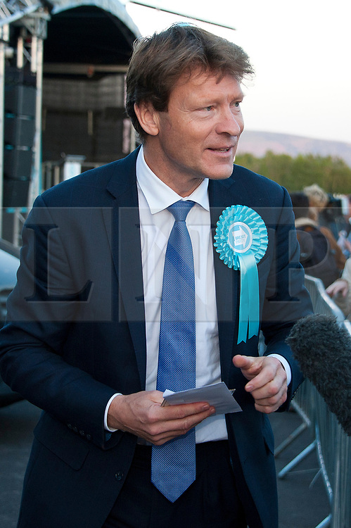 © Licensed to London News Pictures. 15/05/2019. Merthyr Tydfil, Powys, Wales, UK. Richard Tice, Chairman of the Brexit party, speaks at an open-air Brexit Party rally which takes place at Trago Mills in the Welsh, former mining town, of Merthyr Tydfil in Powys, UK. The Brexit Party was founded by former UKIP economics spokeswoman, Catherine Blaiklock in January 2019 to support the winning Brexit vote in the 'Leave or Remain' referendum of 23rd June 2016. Brexit Party members point out that the UK prime minister, Theresa May, has betrayed her electorate by not keeping her pledge that the UK would leave the European Union on March 29th 2019, the date set by invoking article 50 of the Treaty of Lisbon. Photo credit: Graham M. Lawrence/LNP