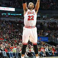24 March 2012: Chicago Bulls forward Taj Gibson (22) takes a jumpshot during the Chicago Bulls 102-101 victory in overtime over the Toronto Raptors at the United Center, Chicago, Illinois, USA.