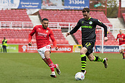 Elliott Frear of Forest Green Rovers is challenged by Keshi Anderson of Swindon Town during the EFL Sky Bet League 2 match between Swindon Town and Forest Green Rovers at the County Ground, Swindon, England on 7 March 2020.