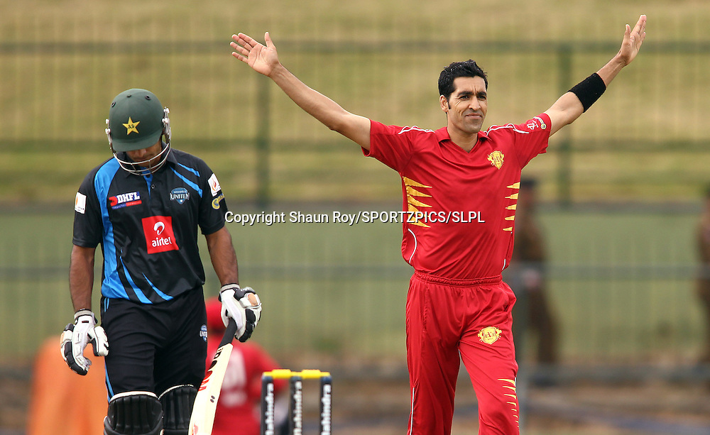 Umar Gul of Uva Next celebrates Mohammad Hafeez of Wayamba United wicket during match 7 of the Sri Lankan Premier League between Wayamba and Uva Next held at the Pallekele Stadium in Kandy, Sri Lanka on the 17th August 2012<br />  <br /> Photo by Shaun Roy/SPORTZPICS/SLPL