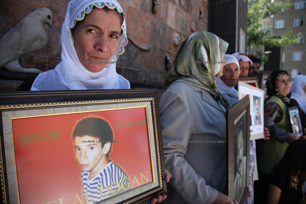 Relatives of disappeared kurdish people protest by holding portrait images of their loved ones downtown Diyarbakir.