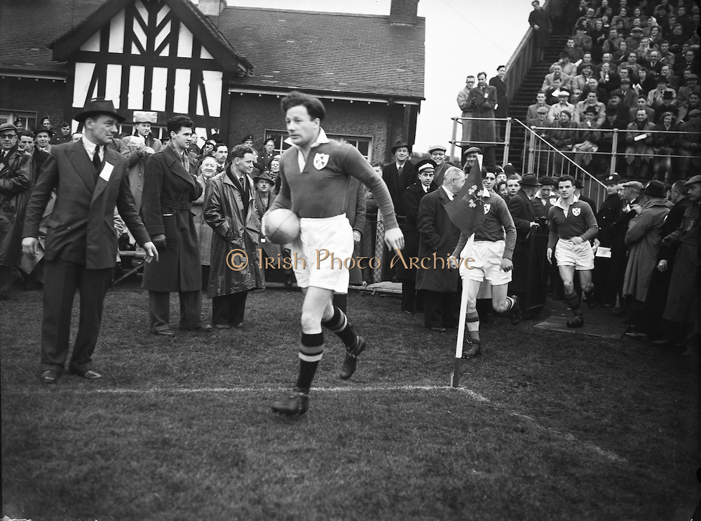 Irish Rugby Football Union, Ireland v England, Five Nations, Landsdowne Road, Dublin, Ireland, Saturday 14th February, 1953,.14.2.1953, 2.14.1953,..Referee- MR A W C Austin, Scottish Rugby Union, ..Score- Ireland 9 - 9 England, ..Irish Team,..R J Gregg, Wearing number 15 Irish jersey, Full Back, Queens University Rugby Football Club, Belfast, Northern Ireland,..M F Lane,  Wearing number 14 Irish jersey, Right wing, University college Cork Football Club, Cork, Ireland,  ..N J Henderson, Wearing number 13 Irish jersey, Right centre, N.I.F.C, Rugby Football Club, Belfast, Northern Ireland,..K Quinn, Wearing number 12 Irish jersey, Left Centre, Old Belvedere Rugby Football Club, Dublin, Ireland,  ..M Mortell, Wearing number 11 Irish jersey, Left wing, Bective Rangers Rugby Football Club, Dublin, Ireland,.  .J W Kyle, Wearing number 10 Irish jersey, Stand Off, Captain of the Irish team, N.I.F.C, Rugby Football Club, Belfast, Northern Ireland,..J A O'Meara, Wearing number 9 Irish jersey, Scrum, University college Cork Football Club, Cork, Ireland,  ..W A O'Neill, Wearing number 1 Irish jersey, Forward, University College Dublin Rugby Football Club, Dublin, Ireland, ..R Roe, Wearing number 2 Irish jersey, Forward, Dublin University Rugby Football Club, Dublin, Ireland,..F E Anderson, Wearing number 3 Irish jersey, Forward, Queens University Rugby Football Club, Belfast, Northern Ireland,..T E Reid, Wearing number 4 Irish jersey, Forward, Garryowen Rugby Football Club, Limerick, Ireland, ..J R Brady, Wearing number 5 Irish jersey, Forward, C I Y M S Rugby Football Club, Belfast, Northern Ireland, .  .J S McCarthy, Wearing number 6 Irish jersey, Forward, Dolphin Rugby Football Club, Cork, Ireland, ..R Kavanagh, Wearing number 7 Irish jersey, Forward, University College Dublin Rugby Football Club, Dublin, Ireland,..W E Bell, Wearing number 8 Irish jersey, Forward, Collegians Rugby Football Club, Belfast, Northern Ireland,.  .Engish Team,..N M Hall, Wearing number 1 Engish jer