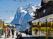"The Wetterhorn or ""Weather Peak"" (12,143 feet) rises above Kleine Scheidegg train station in the Berner Oberland, Switzerland, the Alps, Europe. Wengernalpbahn, the world's longest continuous rack and pinion railway, goes from Grindelwald up to Kleine Scheidegg and down to Wengen and Lauterbrunnen. From Kleine Scheidegg, another cog train (Jungfraubahn) ascends steeply inside the Eiger to Jungfraujoch, the highest railway station in Europe. The Bernese Highlands are the upper part of Bern Canton. UNESCO lists ""Swiss Alps Jungfrau-Aletsch"" as a World Heritage Area (2001, 2007)."