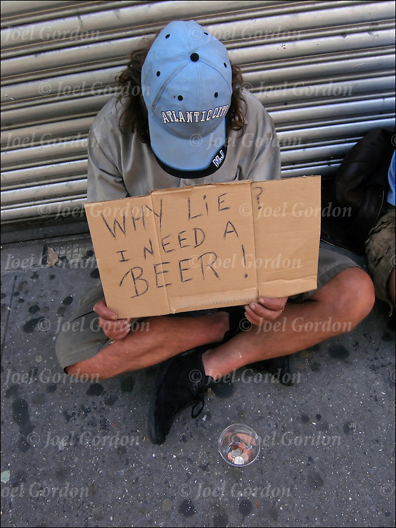 "Homeless streetperson begging for handouts in New York City. Holding sign ""Why Lie? I Need a Beer!"""
