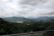 Japanese mountainous rural landscape in the Hiroshima prefecture seen from a traveling bus