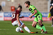 Forest Green Rovers Dayle Grubb(8) takes on Northampton Towns Billy Waters(20) during the EFL Sky Bet League 2 match between Northampton Town and Forest Green Rovers at Sixfields Stadium, Northampton, England on 13 October 2018.